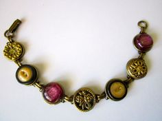 Antique BUTTON bracelet with 1800s buttons in pink, black & brass. One of a kind