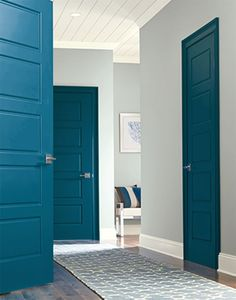 Sherman Williams vivid color paint 6943 intense teal on the doors, 765 710 Smith on the walls, 7005 pure white on the trim Interior Door Colors, Painted Interior Doors, Door Paint Colors, Painted Doors, Interior Painting, Dark Interior Doors, Painted Bedroom Doors, House Paint Interior, Interior Ideas
