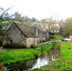 The beautiful village of Bibury, Cotswolds,  England, UK.  How lovely I want to see this on person.