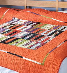 """Jelly Belly from Easy Quilts Fall 2013 is a bed size quilt that is made using pre-cut 2½""""-wide strips. Quilt by Brigitte Heitland."""