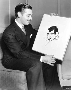 "Full shot of Clark Gable, 1936,  holding sketch drawn by Steindl during filming of ""Wife vs Secretary."""