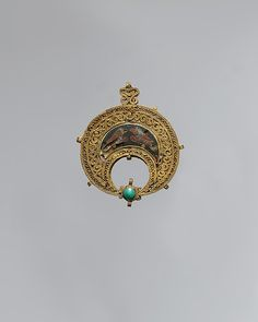 Crescent-Shaped Pendant with Confronted Birds, 11th century. Made in Egypt. Theodore M. Davis Collection, Bequest of Theodore M. Davis, 1915 (30.95.37)