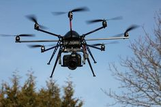An Octocopter carrying a Canon DSLR for aerial cinematography, by MikroKopter Kits: MK BASICSET OKTO XL