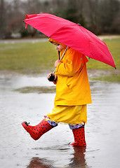 classic shot, yellow slicker and red umbrella and boots.