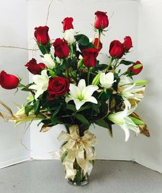 Combining flowers with the traditional red roses can make for an amazing Valentine's Day arrangement.  These lovely flowers are from local florist Wood's Flowers and Gifts of College Park, Maryland.