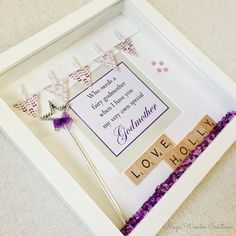 Beautiful Godmother Frame  A perfect keepsake and ideal as a handmade gift for a godmother. The frame measures 23cm by 23cm and available in white.  The frame is designed with the name of the godmother using wooden scrabble letters and a wand to complement the printed message in the middle Who needs a fairy godmother when I have you my very own special Godmother. This message can be personalised in a style of your choice. Small wooden hearts are painted and added to the frame which is…