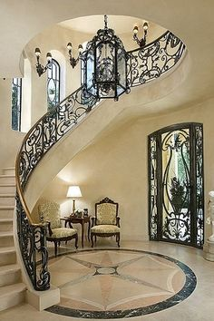 Mediterranean Staircase with Cathedral ceiling, Wall sconce, Jensen Design Custom Rail, Stone Pride Medallion, French doors # stairs # doors # windows Foyer Staircase, Staircase Design, Entryway Stairs, Spiral Staircases, Curved Staircase, Villa Plan, Stairways, My Dream Home, Future House