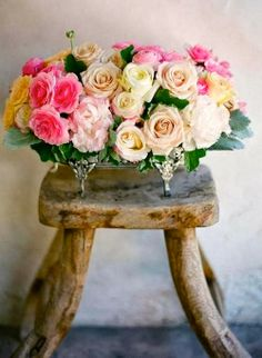 roses in silver container on wooden stool  // Vintage Mulberry: Could It Be Spring Fever?