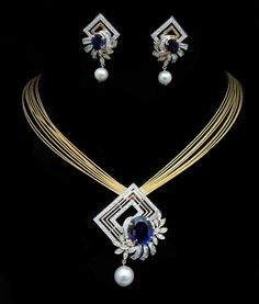 The Magnificent Tanzanite! Charu Jewels is crafted in 18 K gold and set with  in  surrounded by   & pure beauty of Pendant Set, Diamond Pendant, Pendant Jewelry, Diamond Jewelry, Gold Jewelry, Jewelry Trends, Jewelry Sets, Gold Jewellery Design, Men's Jewellery