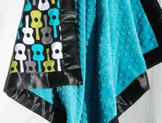 Minky and Satin Baby Blanket- Lagoon Groovy Guitars with Teal Blue Minky and a Black Satin Trim
