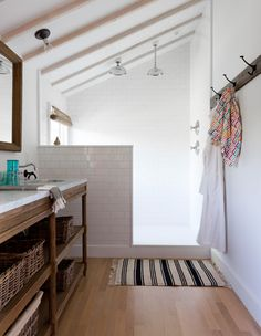 Open shower with half wall, slanted ceiling, and window - White subway - Open vanity console