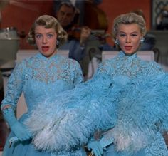 rosemary-clooney-vera-ellen-sisters-dresses-white-christmas ok..no feathers! but...love the sleeves, the lace, the knee length, and the fullish skirt.