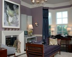 Example of an ornate living room design in New York with purple walls and a standard fireplace
