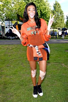 Winnie Harlow: model, spokesperson, activist and all-round babe. Also, a long-sleeved Moschino top, all-orange everything else and a chunky gold chain? INTO IT.