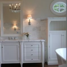 white marble in a bathroom is timeless-as is a white bathroom. Why is it that everyone uses ugly granite?