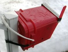 A mailbox made from a bucket