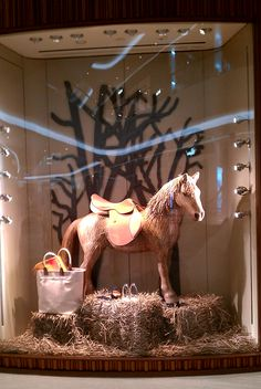 """Hermès,Central Embassy Shopping Mall Bangkok,Thailand,""""The dress makes the person; the saddle the horse"""", pinned by Ton van der Veer"""