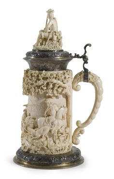 """""""EIGHTEENTH-CENTURY STAG HUNTING SCENE,"""" A SILVER MOUNTED CARVED IVORY TANKARD, Germany, circa 1890"""
