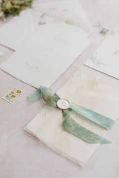 Luxury wedding invitations with beautiful textured handmade papers, hand dyed silk ribbon and wax seal. White and green Mediterranean themed invitations. Luxury Wedding Invitations, Wedding Stationery, Dyed Silk, Watercolor Invitations, Wax Seals, Wedding Paper, Silk Ribbon, Paper Texture, Gift Wrapping