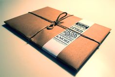 simple parcel packaging with detailed tape. typography.