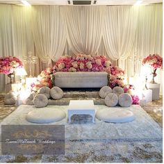 pink dais with white curtain