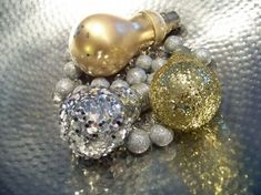 gold and silver glittered christmas tree ornaments made of light bulbs