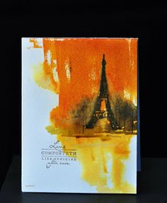 Used  wild honey Distress ink pad and dragged it across the paper. Sprayed  the bottom part, since I 'have' to use water on my paper! Stamped the Eiffel tower and the bare trees from City Scene  while the paper was still damp. The sentiment is from PTI Meadow Greens.