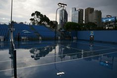 An outside court is deserted during after rain stopped play at the Australian Open tennis championship in Melbourne, Australia. Photo: AP