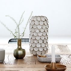 """Dot from House Doctor is a beautiful vase made of glazed ceramic. The product is designed with circular """"dots"""" that create a shield around the vase, House Doctor, Glazed Ceramic, Ceramic Vase, Contemporary Vases, Bohemian House, Interior Design Business, White Vases, Danish Design, Beautiful Interiors"""