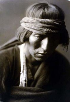 You are viewing an impressive image of Hastobiga Navaho Medicine Man. It was taken in 1904 by Edward S. Curtis.    The picture shows Hastobiga, head-and-shoulders portrait, facing front, looking down.    We have created this collection of pictures primarily to serve as an easy to access educational tool. Contact curator@old-picture.com.    Image ID# 1DADE91F