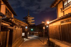 Kyoto by Night - Hokan-ji Shrine looms at the end of a sreet in the Gion district of Kyoto, Japan.