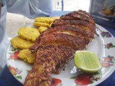 Pescado frito con tajadas de platano. Dish is missing arroz blanco y ensalada de repollo. ;)