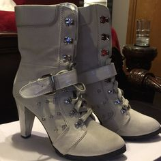Women boots Women boots used good condition. Missing the silver piece in the picture so please look not really noticeable, but these boots still have a lot of life to them. With box. ALDO Shoes Heeled Boots