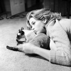 Jane Fonda. Loving her siamese cat. In 1962. Through the lens of Genevieve Naylor.