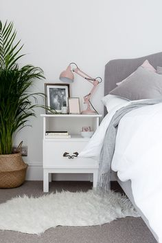 Blush, grey and white bedroom with gold accents