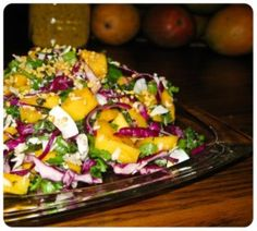 * Bobby Flay's Tropical Slaw with Sweet and Sour Dressing- This salad was so yummy and refreshing! With Red Cabbage, Mango, Pineapple, Cider Vinegar, Cilantro and Green Onions, this salad is perfect for a summer BBQ! http://www.foodnetwork.com/recipes/bobby-flay/tropical-slaw-with-sweet-and-sour-dressing.html