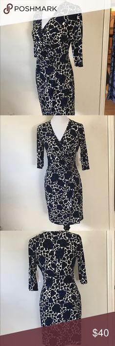 Figure Flattering Wrap Dress Hold you in NWT You will definitely turn heads with this dress. This is a very figure flattering faux Wrap dress that features hold you in Knit technology.  It is black blue and white. Curvy Couture Dresses Midi