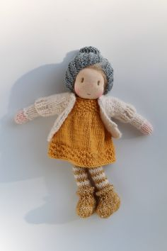 Cute little Tess! Tess is a little Waldorf knitted doll made in The Netherlands from all natural materials: Swiss cotton knit doll fabric, clean carded wool, ultrasoft cotton, eco and fairtrade yarn and a crocheted mohair wig. Her face is hand embroidered and her cheeks are blushed with