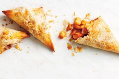 Apple Pie Turnovers—These flaky wonders are a hand-held spin on apple pie. Cover the phyllo pastry with a damp tea towel to prevent the remaining sheets from drying as you assemble the turnovers.