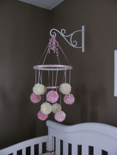 Adorable mobile and really cute way to hang it over the crib!!