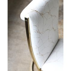 A stunning set of rare vintage Pierre Cardin cantilevered brass dining chairs completely re-upholstered in our Augusta fabric a creamy off white base with metallic gold marbled veins woven in.