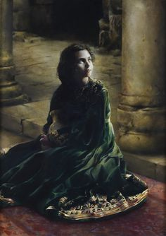 """According To Thy Wordby Elspeth Young This painting presents the moment at which Mary is visited by the angel Gabriel. Her faith and humility, evident in her reply to the angel—""""Behold the handmaid of the Lord; be it unto me according to thy word"""" (Luke 1:38), shine in the clarity and brilliance of her countenance. The light from the heavenly messenger is also mirrored in her face."""