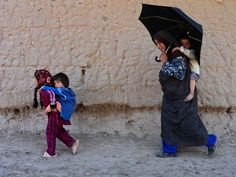 A family walks along a road in Herat, Afghanistan.  Aref Karimi, AFP/Getty Images