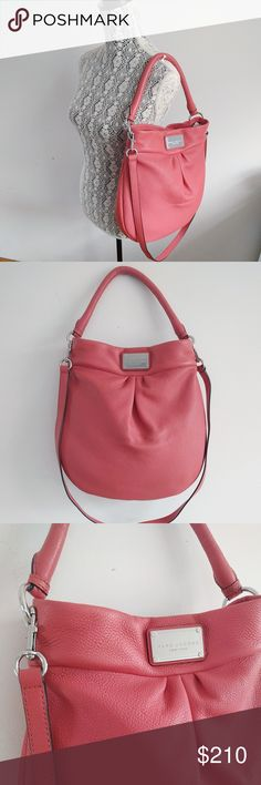 "Marc Jacobs Classic Hillier Leather Hobo Bag NEW Details - Rolled top handle - Detachable shoulder strap - Top magnetic snap button closure - Exterior features pleated front detail, brand name plate, gold-tone hardware, pebbled finish - Interior features 1 zip wall pocket, solid lining - Color: Salmon - Approx. 13.5"" H x 13.5"" W x 2.5"" D - Approx. 6"" handle drop, 21"" shoulder strap drop - Materials: Leather exterior, fabric lining Brand new with tags. Marc Jacobs Bags Hobos"