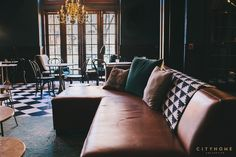 Custom sofa in the lounge of the new Finca restaurant in downtown Salt Lake City. Interior Design by cityhomeCOLLECTIVE