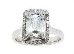 18 karat white gold custom halo ring. Set in the center is one prince cut diamond=1.79 carats total weight, H color, SI1 clarity grade, GIA report. Halo is set with round brilliant cut diamonds=0.24 carat total weight