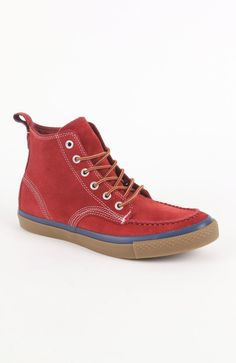 54.99 Mens Converse Shoes -  Online Exclusive! Pieced red suede upper. Hi-top shoe, rope lace front. All Star logo on heel. Padded insole. Man made rubber textured outsole. Size 10 shown.