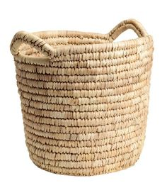 Natural. Large storage basket in braided straw with two handles at top. Height 11 1/2 in., diameter 11 1/2 in.