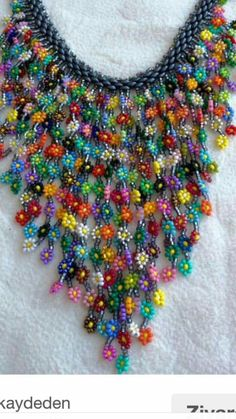 Hand-knitted flowers by using beads Seed Bead Necklace, Seed Bead Jewelry, Jewelry Making Beads, Flower Necklace, Beaded Jewelry, Handmade Jewelry, Beaded Necklace, Knitted Flowers, Beaded Flowers