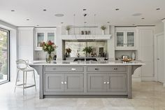 Kitchen Updating Ideas The impressive island adds much needed extra storage and work surface space, perfect for busy family living. Placed in the centre of the kitchen, it creates a hub for friends and family to gather. A large Kohler sink, with Perrin Open Plan Kitchen Living Room, Kitchen Design Open, Luxury Kitchen Design, Luxury Kitchens, Home Decor Kitchen, Interior Design Kitchen, New Kitchen, Home Kitchens, Elegant Kitchens